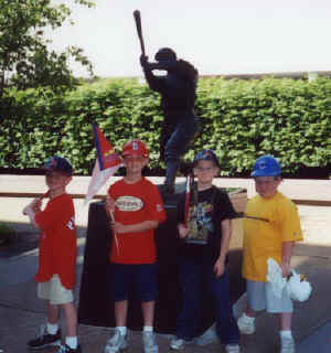 Tyler and friends in front of Busch Stadium statue